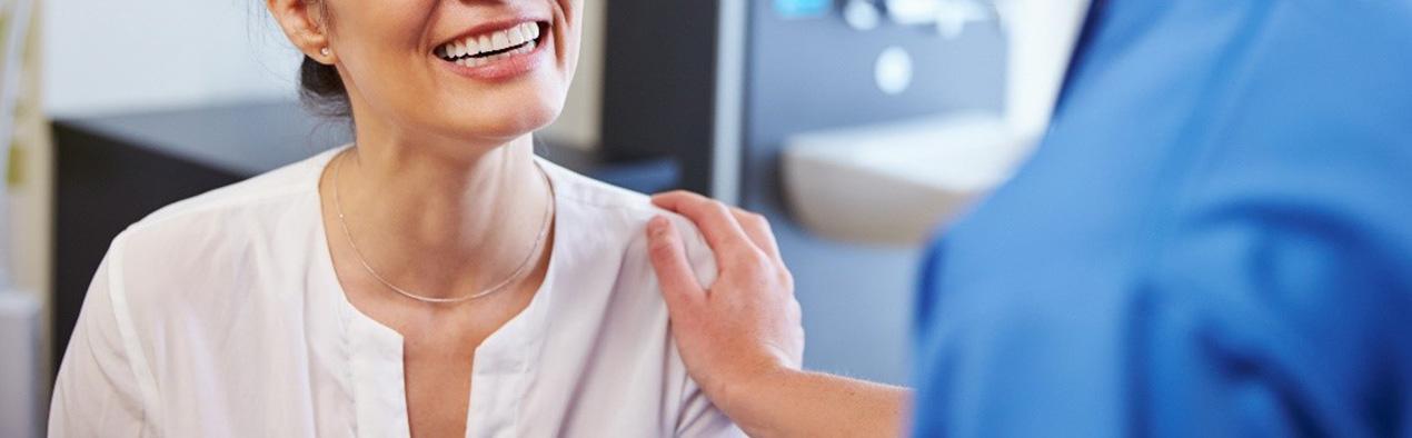 Patient smiling at nurse