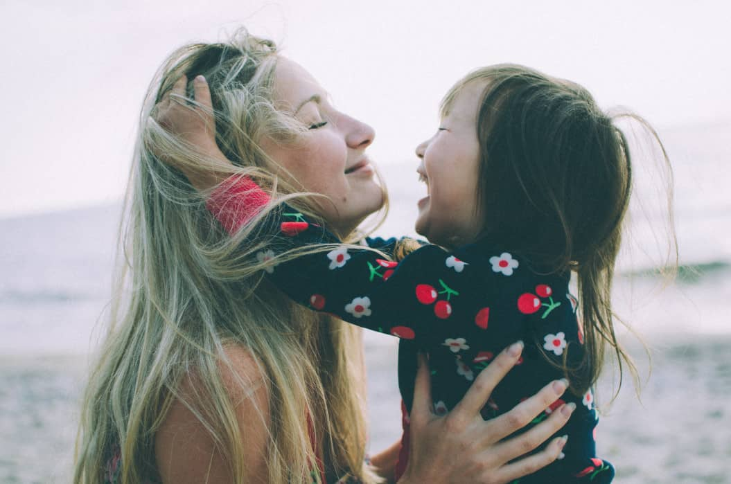 Woman smiling holding daughter